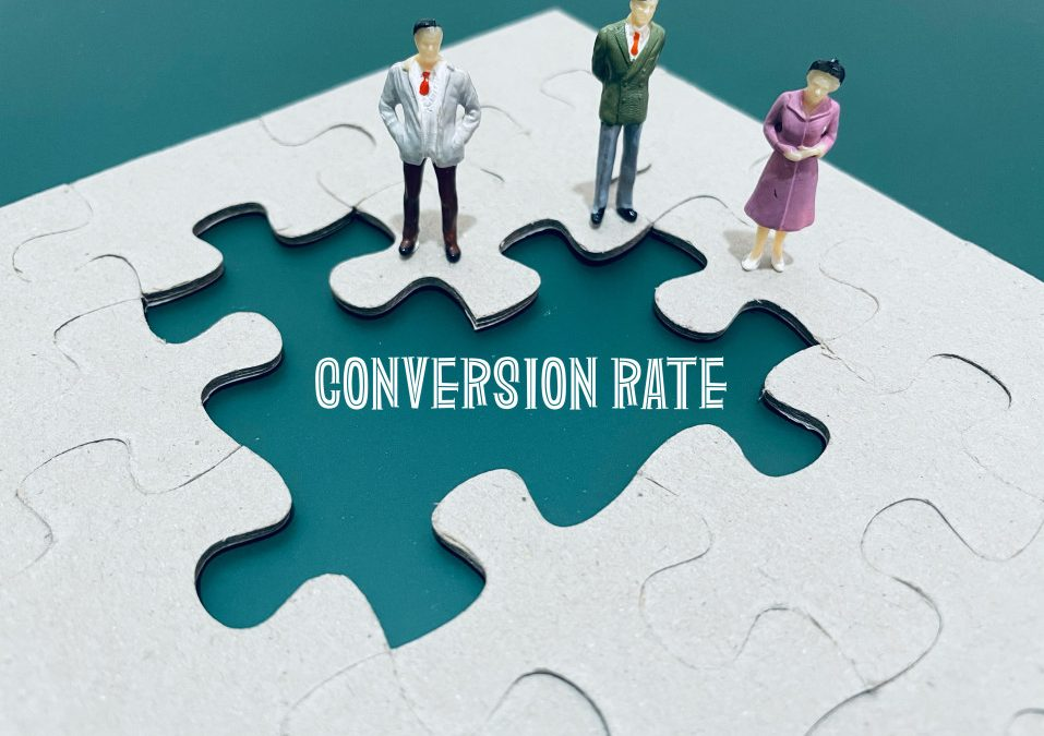 """An enlarged white puzzle on a teal blue background. Three pieces in the middle of the puzzle are missing and cartoon people stand near the open space. The open space reads """"conversion rate."""""""
